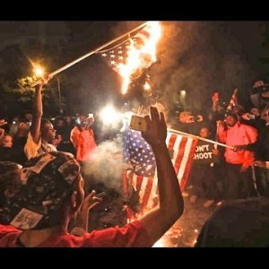 Ferguson Protesters Burning American Flag - YouTube Screenshot