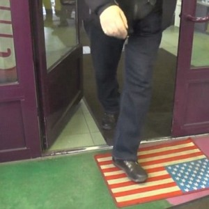 http://endoftheamericandream.com/wp-content/uploads/2014/12/American-Flag-Doormat-Video-Screenshot-300x300.jpg